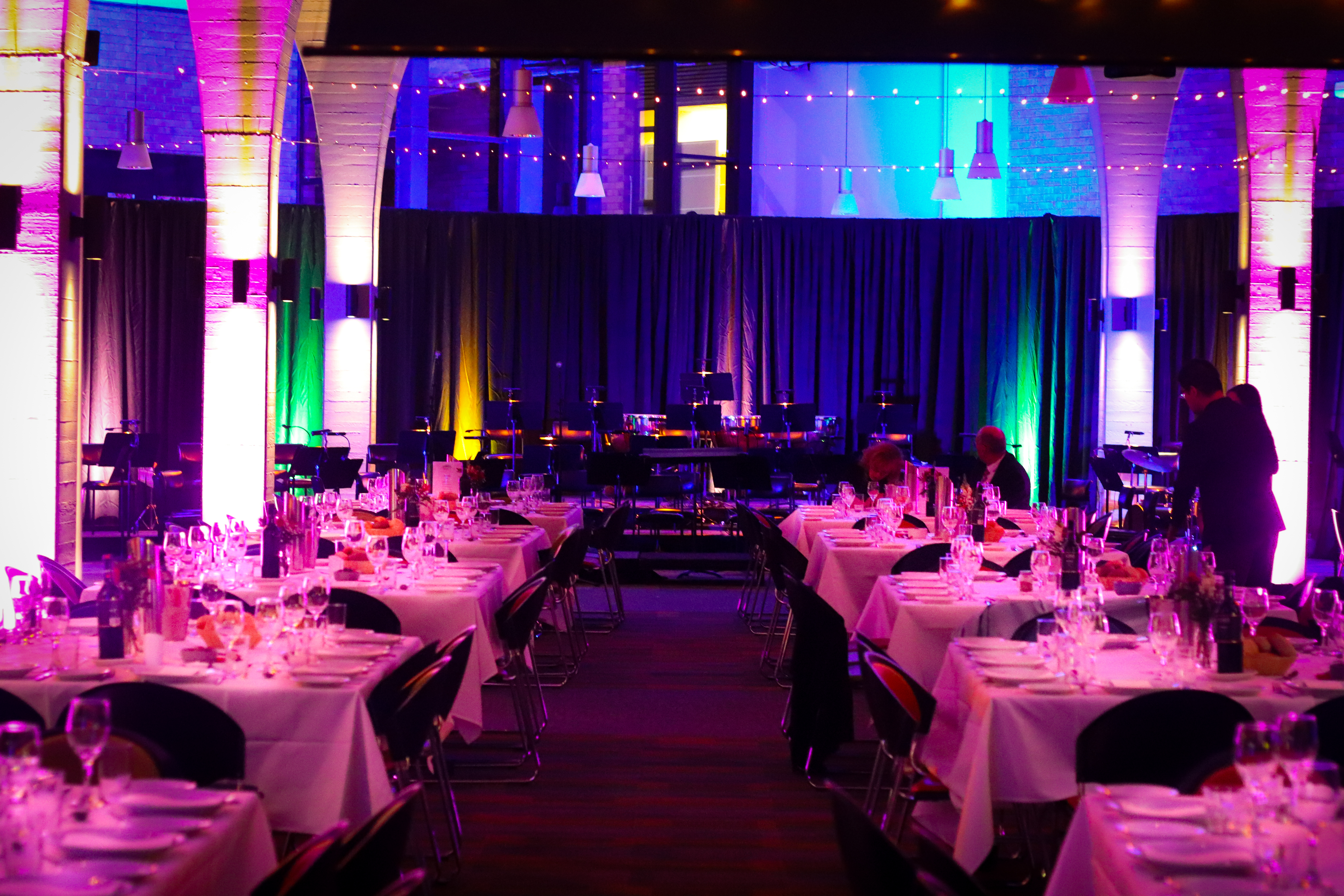 Photo of tables set up in Toowoomba venue, with stage in background