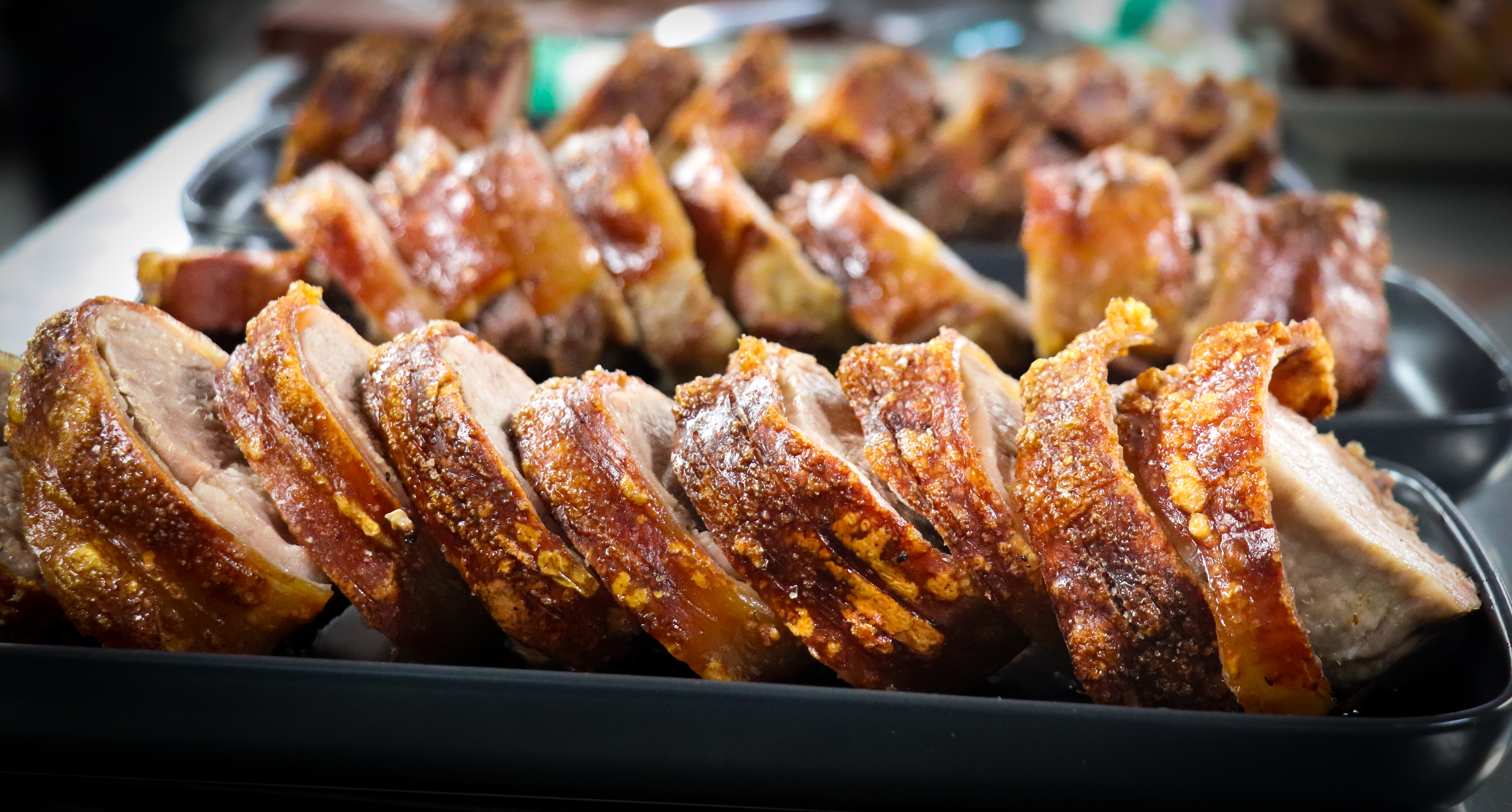 Plates of Roasted Pork with crackling