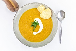 Top down image of a bowl of pumpkin soup